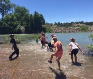 NRCP camp kids in river